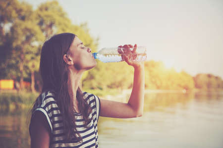 water park: Woman drinking water Stock Photo
