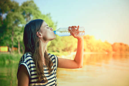 summer diet: Woman drinking water Stock Photo
