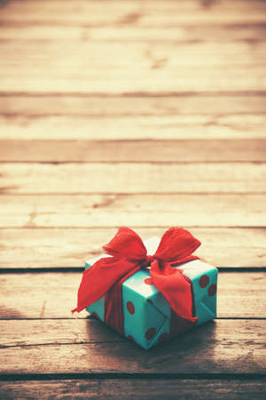 text year: gift box on wooden table as natural background with copyspace