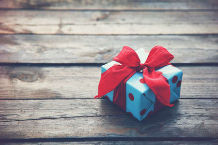 bows: gift box on wooden table as natural background with copyspace