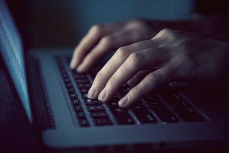 hands with laptop typing in night Foto de archivo