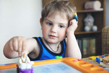 boys playing: cute boy playing with toys