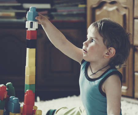 little boys: cute boy playing with toy blocks and bricks