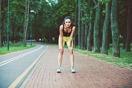 WOMAN FITNESS: tired girl jogging at morning park
