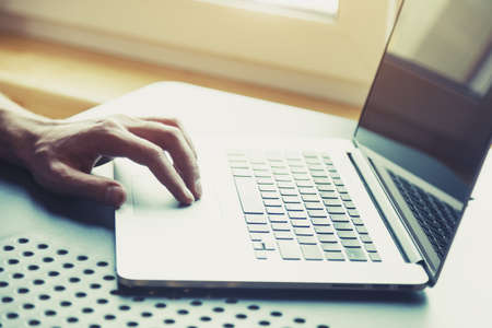 male hand working with laptop