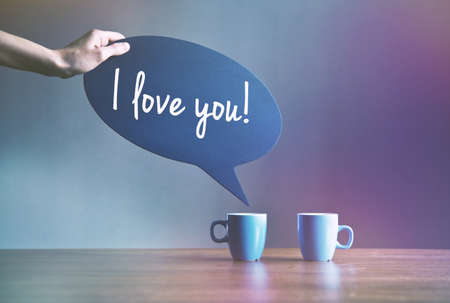 two cups of coffee with bubble plate as dialog with text I love you