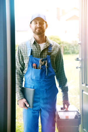 Portrait of handsome worker, service man, plumber or electric