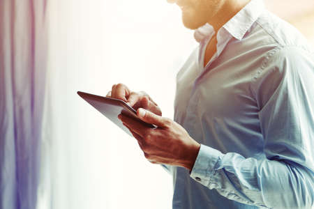 businessman holding digital tablet touching with finger