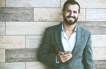 Handsome businessman using smart phone Stock Photo