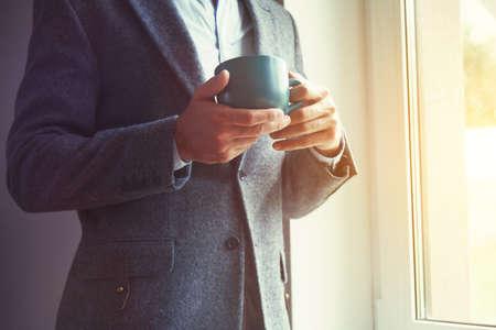 businessman hand holding morning tea or coffee Stock Photo