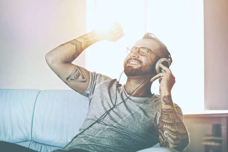 happy emotional man listening to music with headphones Stock Photo