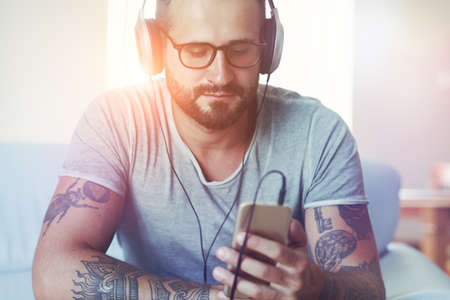 man listening to music with headphones and smart phone