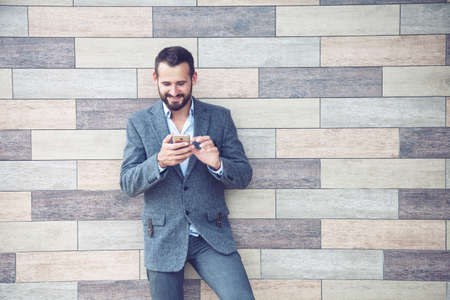Handsome businessman using smart phone Stock Photo