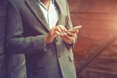 businessman hand using phone