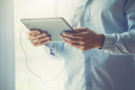 male hands holding digital tablet Stock Photo