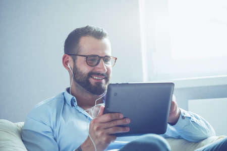 businessman with digital tablet and earphones Stock Photo