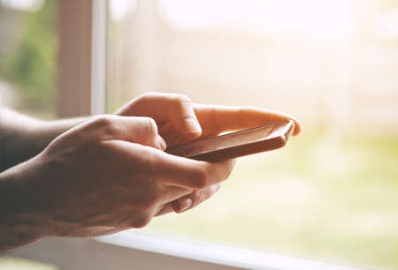 Hands using smart phone touching screen with fingers