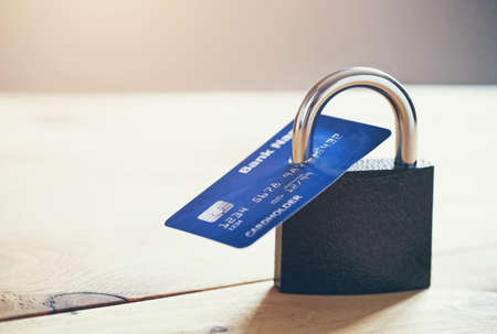 Lock with credit card. Safe shopping and protected paying concept