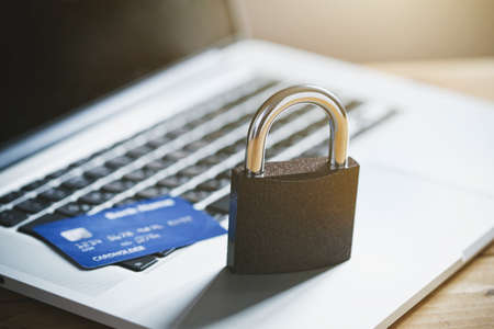 Lock with credit card and laptop. Safe online shopping and protected paying concept