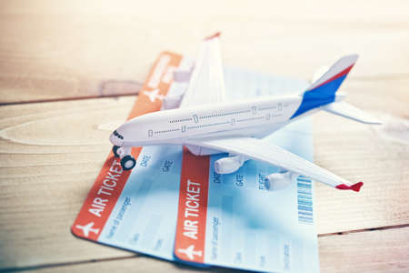 Plane model with tickets as airplane traveling and tickets booking concept