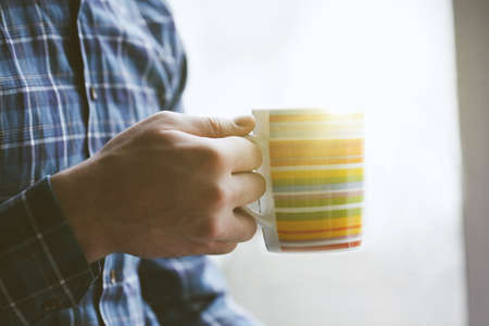 man with cup of morning coffee or tea