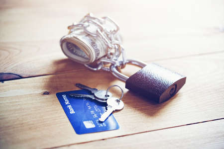 Credit card and locked chain with cash money. Protected paying and money keeping concept