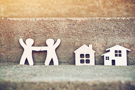 little wooden men and house on natural background. Symbol of construction, neighborhood, sweet home concept