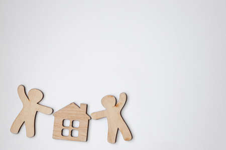 little wooden men and house with blank white space for text or logo. Symbol of construction, family, sweet home concept