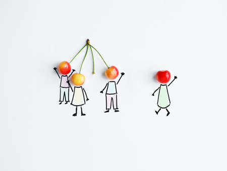 Cherry with hand drawing shapes of team or friends. One is joining to group Stockfoto