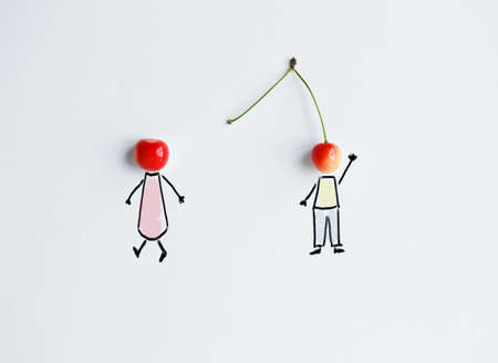 Cherries with hand drawing shapes of loving couple. One is going away