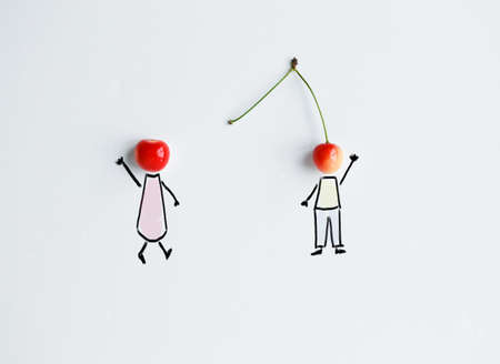 Cherries with hand drawing shapes of loving couple