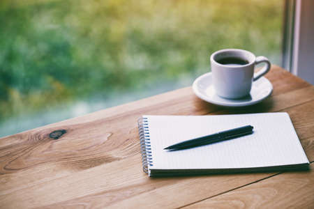 cup of fresh morning coffee with paper notebook and pen for writing 스톡 콘텐츠 - 108417365