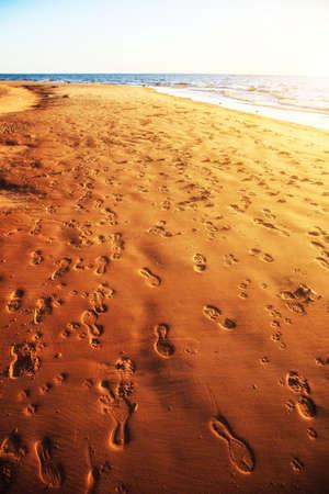 Sandy seaside with footprints