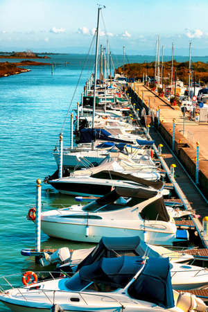 Row of small yachts and boats at sea bay