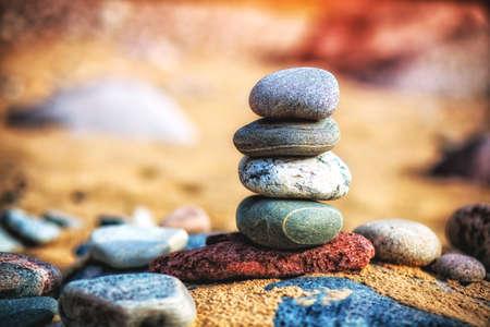 Sea pebble stones tower on beach. Balance and harmony concept Stock Photo