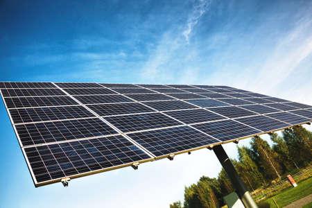 Solar energy panels on sky background