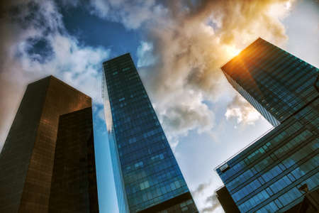 View of geometric business center skyscrapers with sky reflection Stock Photo
