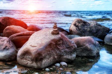 Sea pebble tower on stones. Balance and harmony concept