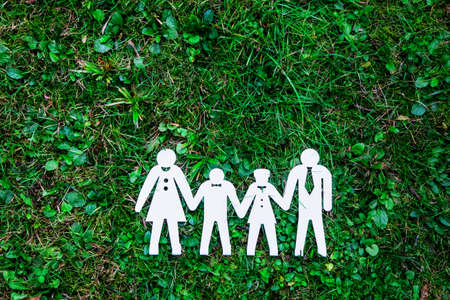 symbol of family on natural green grass background Stock Photo