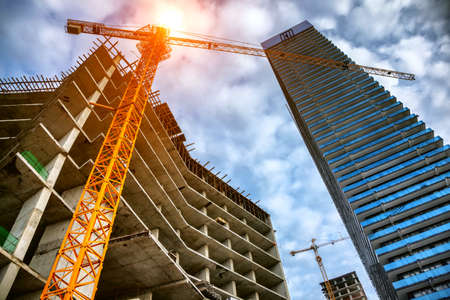 construction site with cranes and buildings
