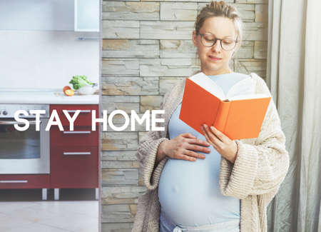 Pregnant woman with belly reading book and text Stay home. Home isolation and quarantine during coronavirus covid-19 pandemic. Imagens - 146261464