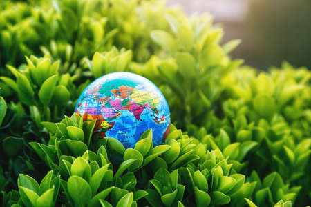 Planet earth model in green plants. Ecology, atmosphere and environment concept. Imagens