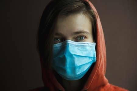 Portrait of woman wearing medical mask. Protection from catching disease. Pandemic of coronavirus concept. Imagens - 146262116