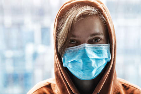 Portrait of woman wearing medical mask. Protection from catching disease. Pandemic of coronavirus concept.