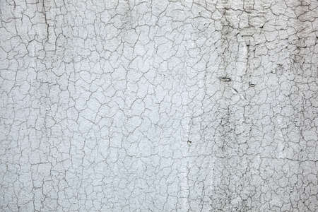 Texture of old paint. Aged cracked plaster on wall background