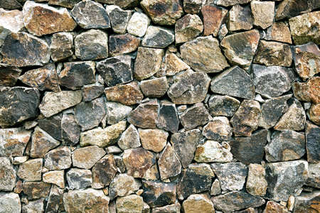 Texture of old stone wall. Aged granite masonry background