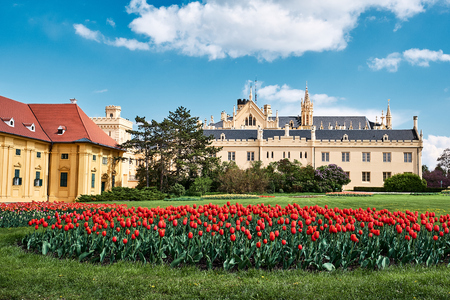 Beautiful view of lednice castle with storm clouds and blooming red tulips lednice palace is one. South Moravia.Czech Republic.