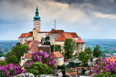 Mikulov castle or mikulov chateau on top of rock colorful panorama view over rooftops on the city