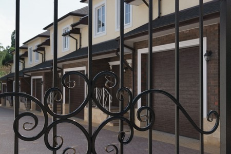 townhouses: new townhouses behind the bars of iron gate