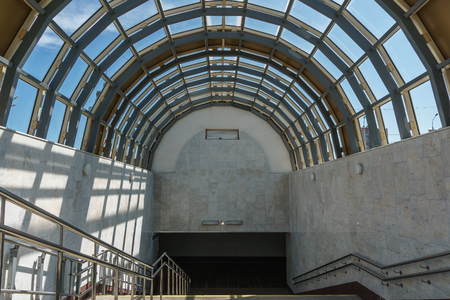 descent into the subway. A wide staircase and a glass roof in the form of an arch Stock Photo